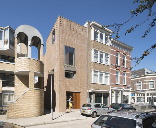 This townhouse has bricks made up of industrial waste