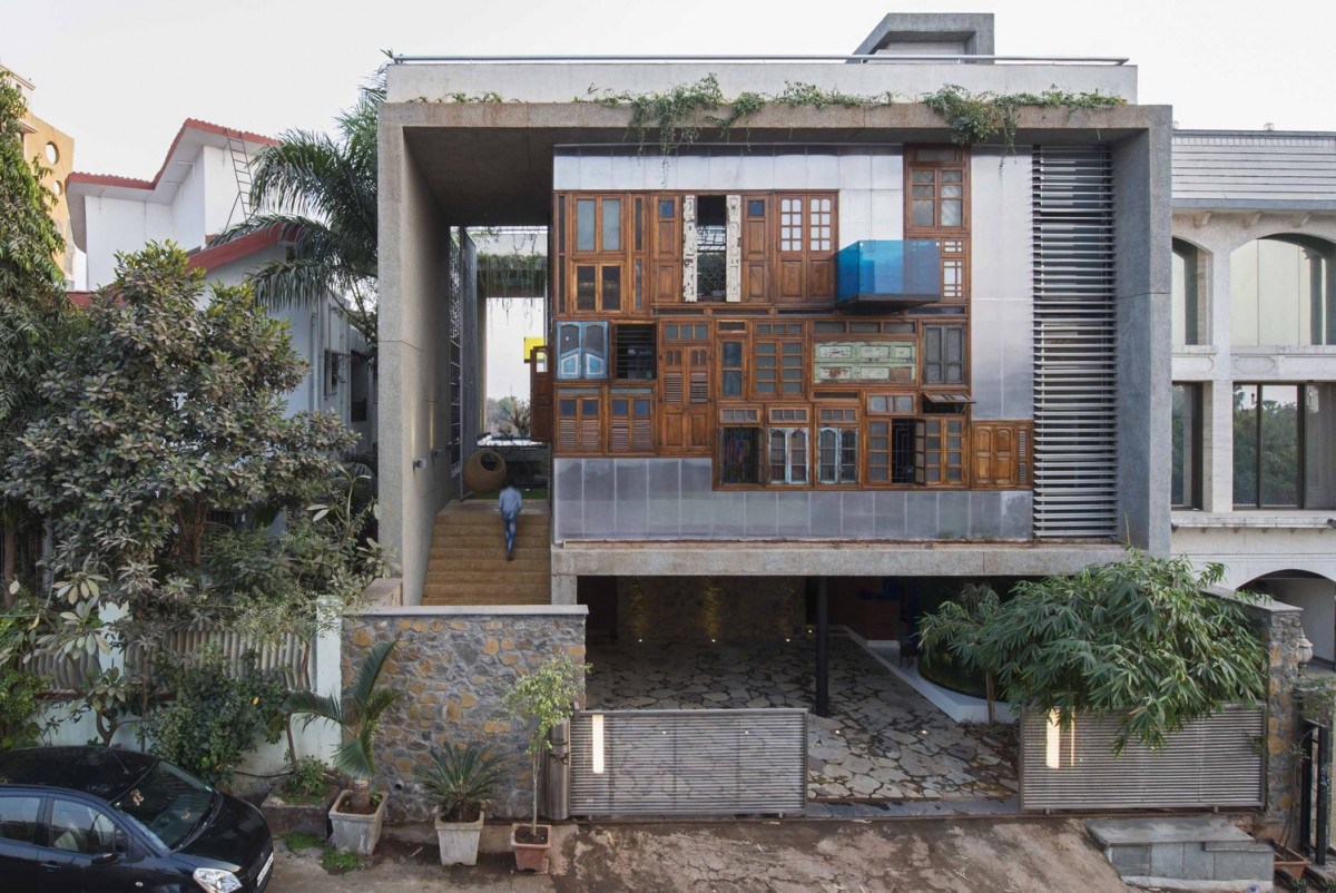 Reclaimed doors and windows make up the façade of this innovative house