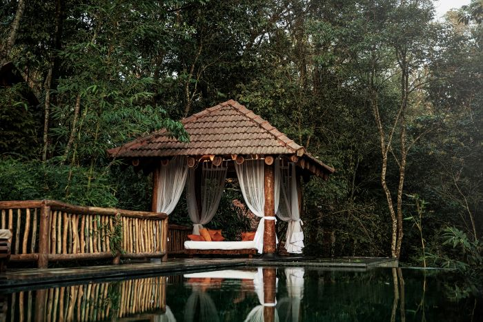 Earthitects,Stone Lodge Wayanad, Villa in Kerala, sustainable architecture, vernacular design,  National Geographic, Nature hidden villa, luxury villa india, Evolve Back Resorts, Apiculture at home,