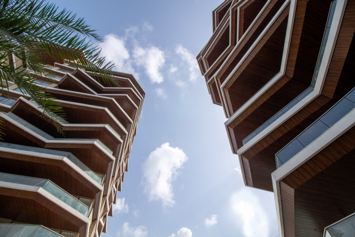 Large overhangs reduce heat gain in response to the hot climate of the city