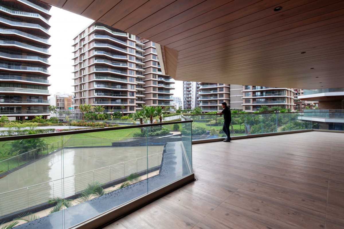 Large balconies act as interstitial spaces between the outside and the inside