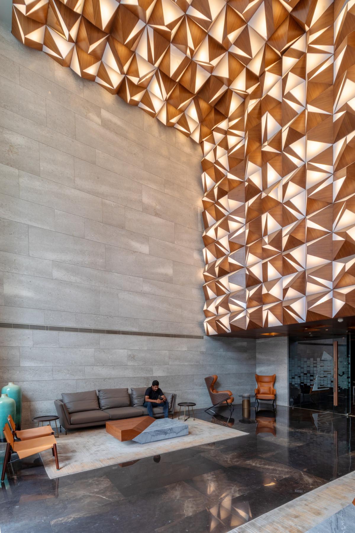 Each building is entered through a sculptural lobby